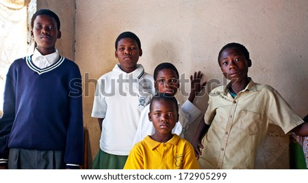 MBABANE, SWAZILAND - AUGUST 5: Unidentified orphan Swazi children on August 5, 2008 in Mbabane, Swaziland. Close to 10 percent of Swaziland's total population are orphans, due to HIV/AIDS. - stock photo