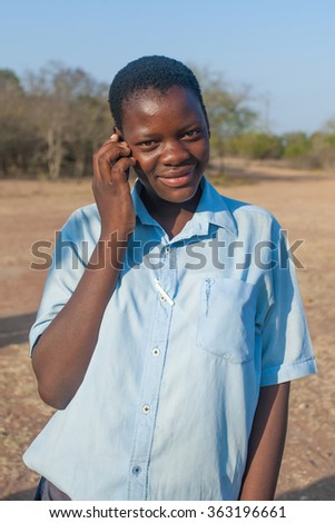 MBABANE, SWAZILAND - AUGUST 6: Unidentified orphan Swazi schoolgirl in a local school on August 6, 2008 in Mbabane, Swaziland. 10 percent of Swaziland's total population are orphans, due to HIV/AIDS. - stock photo