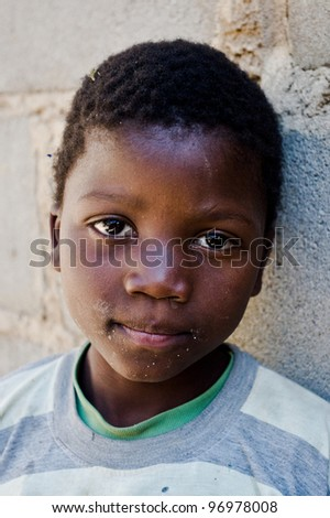 MBABANE, SWAZILAND- JULY 30: Portrait of unidentified Swazi boy on July 30, 2008 in Mbabane, Swaziland. Close to 10 percent of Swaziland's total population are orphans, due to HIV/AIDS. - stock photo