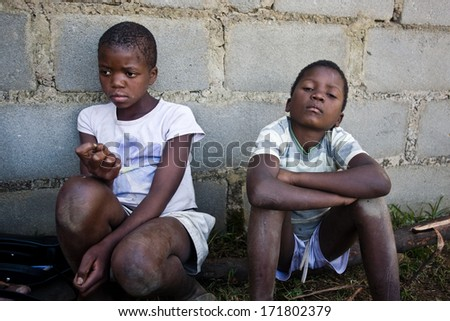 MBABANE, SWAZILAND- JULY 30: Portrait of unidentified Swazi girl and boy on July 30, 2008 in Mbabane, Swaziland. Close to 10 percent of Swaziland�s total population are orphans, due to HIV/AIDS. - stock photo