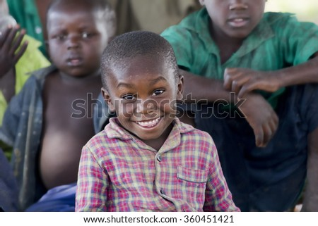 MBALE, UGANDA - FEBRUARY 3, 2011: Cheerful and happy kid from Eastern Uganda smiling to the camera