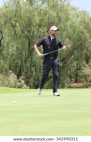 MCFADDEN, BRIAN - NOVEMBER 15: Singer-songwriter and TV presenter Playing at Gary Player Charity Invitational Golf Tournament putting short but smiling on November 15, 2015, Sun City, South Africa.  - stock photo