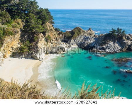 McWay Falls is an 80-foot waterfall located in Julia Pfeiffer Burns State Park that flows year-round. - stock photo