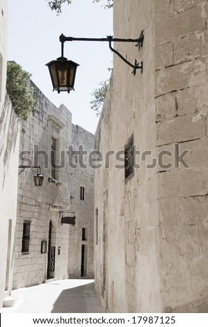 mdina malta alley street ancient medieval town old architecture with maltese street lamp
