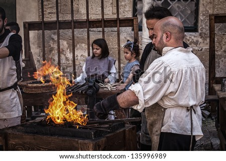 MDINA, MALTA - APR 13 : A medieval blacksmith forges steel during the Medieval Mdina festival in Mdina, Malta on April 13, 2013