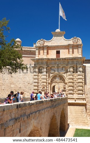 MDINA, MALTA - JULY 29: The view of the main entrance to Mdina with the Main Gate and the Mdina Gate Bridge over Lorenzo Calleja ditch. Malta