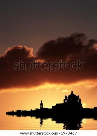 Mdina, medieval silent city of Malta, silhouetted against sky at dusk - stock photo