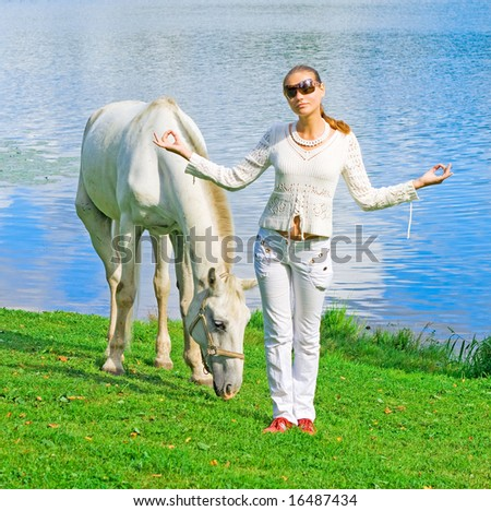 me and my horse by a lake
