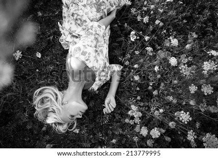 meadow and beautiful woman - stock photo