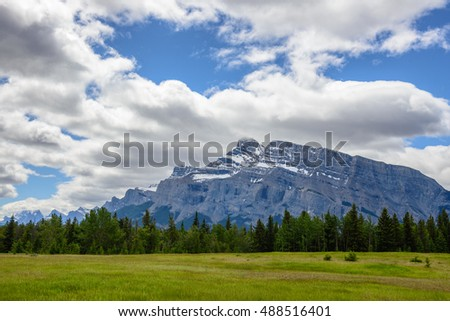 Meadow, forest and mountains on a cloudy day in Banff national park, Canadian rockies