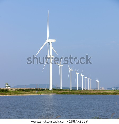 Meadows rivers wind farm - stock photo