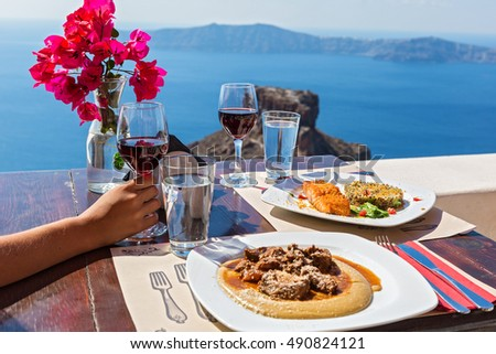 Meal for two at a street restaurant in Santorini, overlooking the volcano