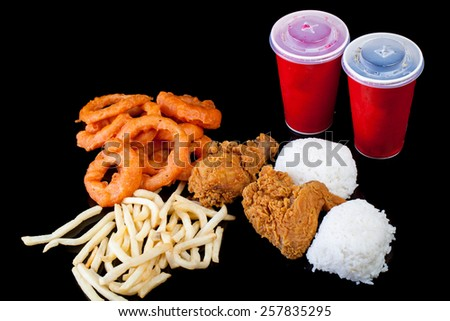 Meal Package Chicken Onion Ring French Fries Rice Drink - stock photo