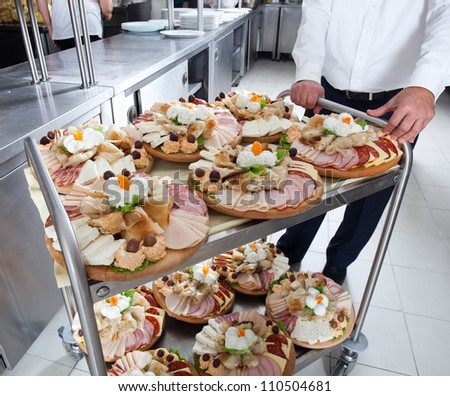 Meals on food trolley ready to be served - stock photo