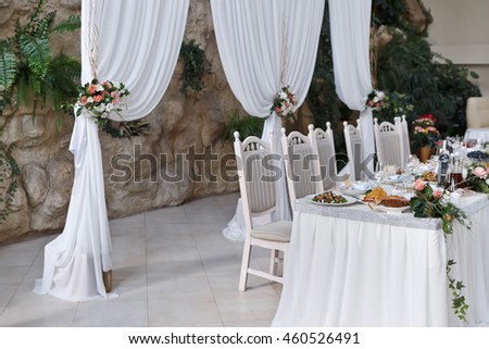 Meals served on wedding party table in restaurant