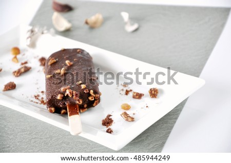 Mealting chocolate ice cream bar on white tray