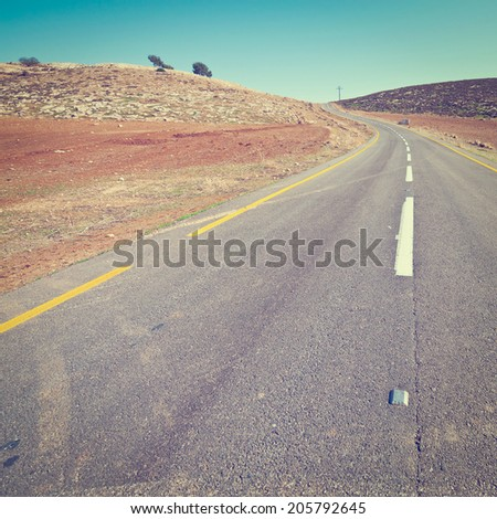 Meandering Road in Sand Hills of Judean Mountain, Israel, Instagram Effect - stock photo