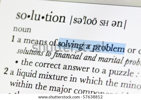Meaning of solution in online dictionary and hilight at solving a problem word - stock photo