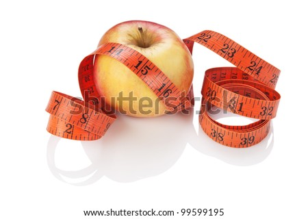 measure tape and apple isolated on white background - stock photo