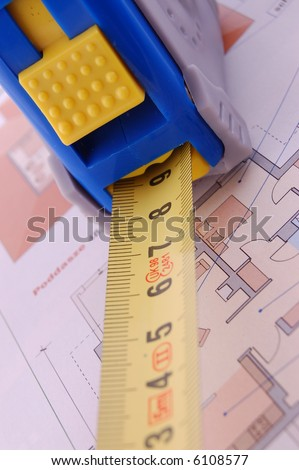 Measure tape and construction plan