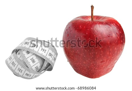 Measure tape and red apple on the white background. - stock photo