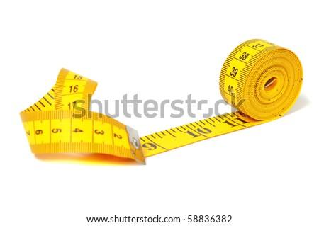 Measure tape over white - stock photo