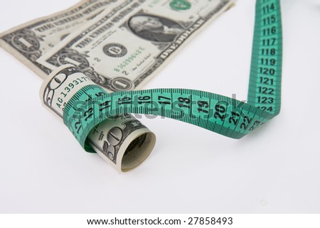 measure tape with american money - stock photo