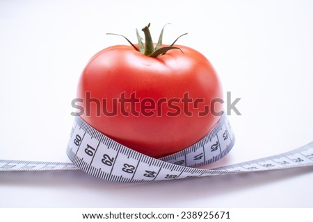 measure tape with tomato