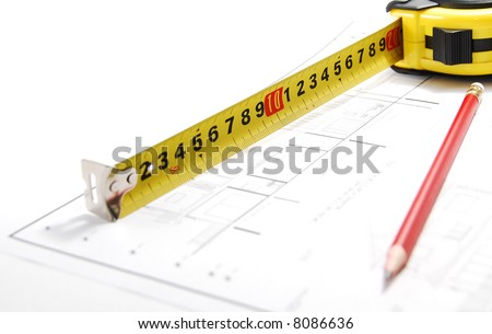 measure up and plan: measuring tape and a pencil over a construction drawing - stock photo