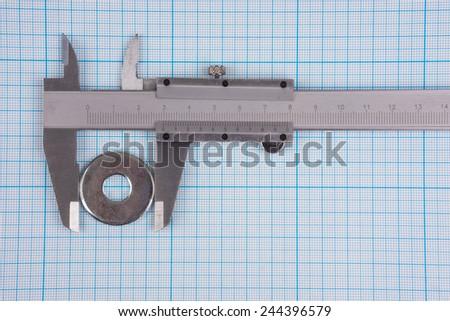 Measurement of bolt spacer diameter with vernier-caliper  - stock photo