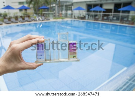 Measurement of chlorine and PH of a pool   - stock photo