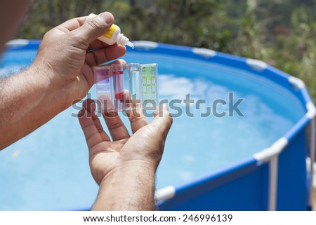 Measurement of chlorine and PH of a pool  calibrator - stock photo