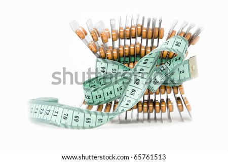 measurement tape and orange blisters, lost weight concept - stock photo