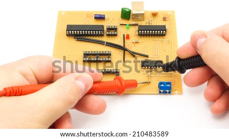Measuring A Circuit Board Using Multimeter Probes.