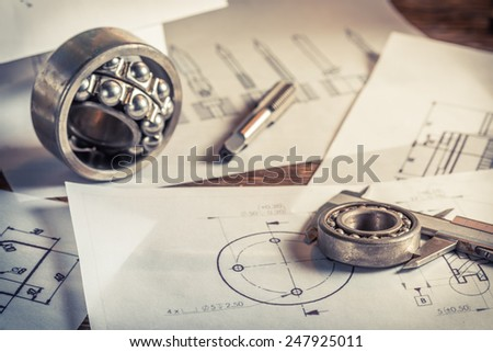 Measuring and comparing the results of the bearings with mechanical scheme - stock photo