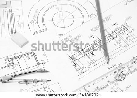 Measuring and drawing instruments and drawings on the table