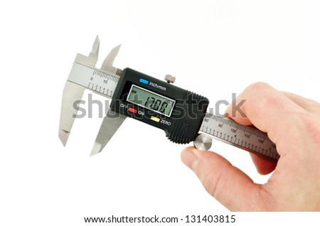 measuring callipers in hand ready - stock photo