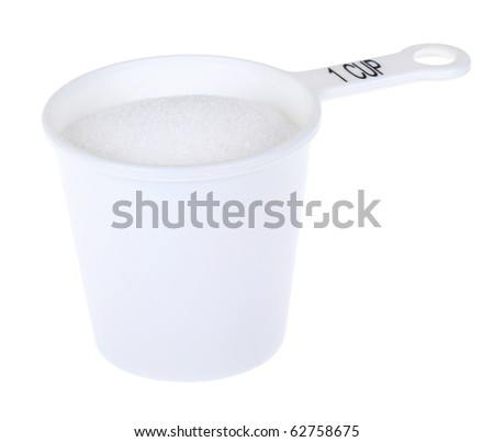 Measuring cup with one cup of sugar isolated on white - stock photo