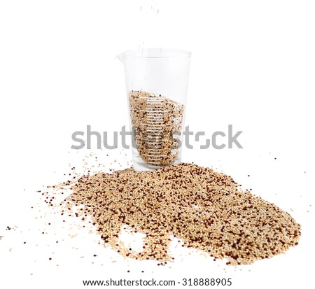 Measuring Cup with quinoa - stock photo