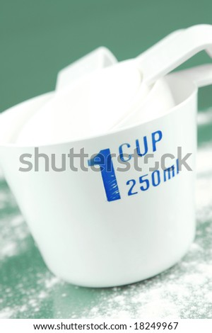 Measuring cups isolated against a green background