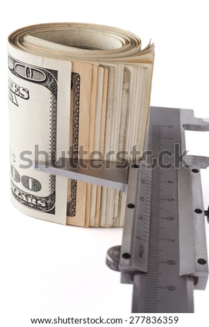 Measuring dollar banknotes with caliper isolated on white background - stock photo