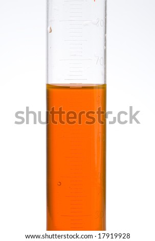 measuring liquid in a test tube - stock photo