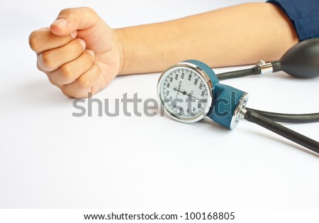 measuring patient blood pressure of people in Asia