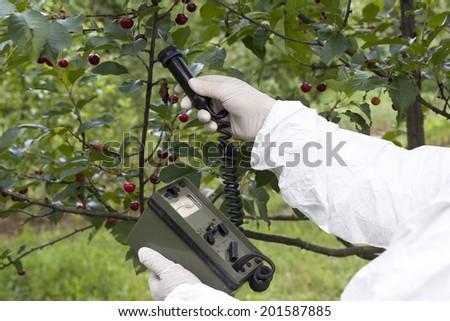 Measuring radiation levels of fruits - stock photo