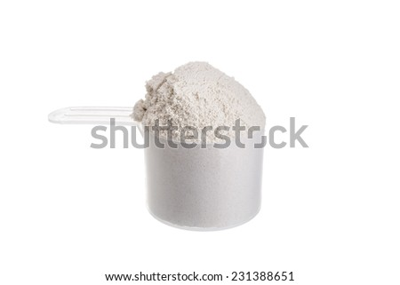 Measuring spoon for milk whey protein. On a white background. - stock photo