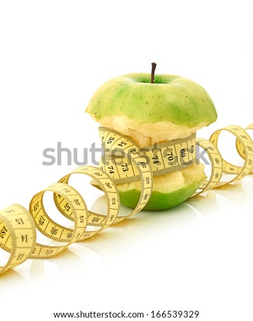 measuring tape and apple