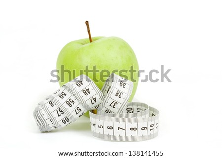 Measuring tape and green apples as a symbol of diet on white background