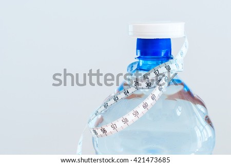 Measuring Tape Around Bottle Water Health Grey Background Weight Loss Clean Food Concept