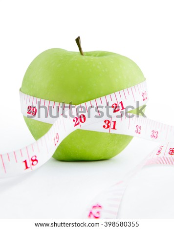 Measuring tape around Green Apple in lose weight concept, Isolated on white background.
