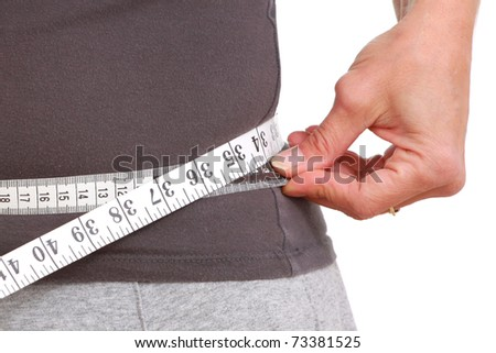 Measuring tape around the waist - stock photo